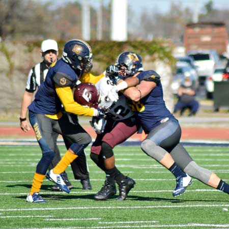 Chalice Keith/The News DeQuinten Spraggins and Zach Dean make a tackle in their loss to EKU Saturday.