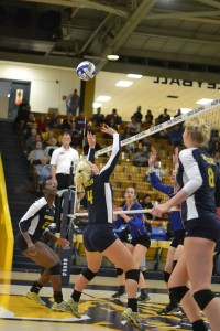 Photo by Chalice Keith/The News Senior setter Sam Bedard sets to ball for sophomore middle blocker Olivia Chatman during their last game of the season Saturday.