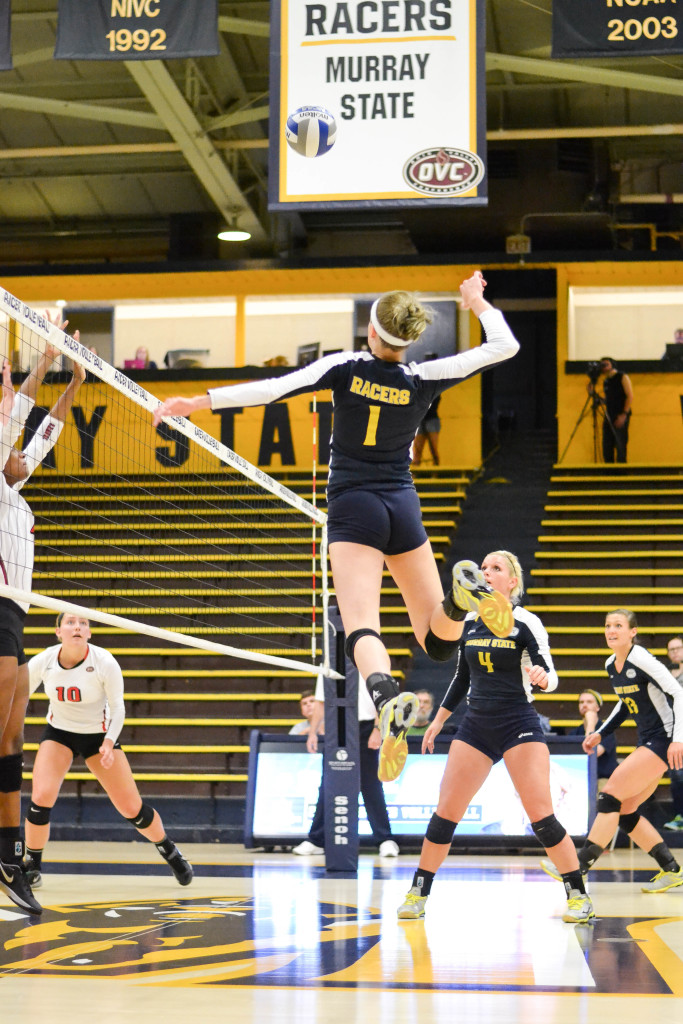 Chalice Keith/The News Senior middle blocker Ayssa Lelm jumps for the spike against SEMO on Friday night in Racer Arena.