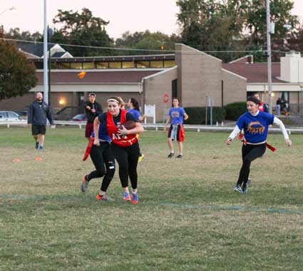 Nicole Ely/The News Hester Residential College plays against Alpha Gamma Delta A in an intramural football game in late October.