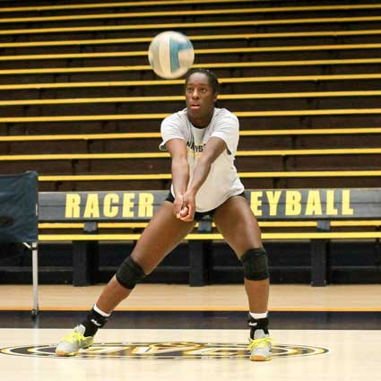 Jenny Rohl/The News Sophomore middle blocker, Olivia Chatman, passes the ball during practice Tuesday.
