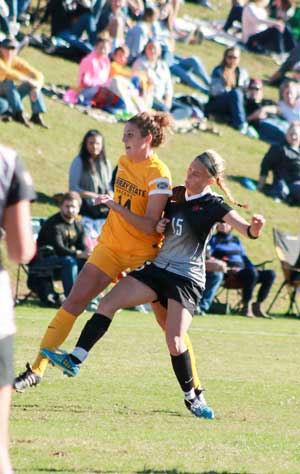 Jenny Rohl/The News Sophomore defender Mazie Fry shields off a SEMO forward to help complete the shutout.
