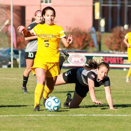 Jenny Rohl/The News Junior Taylor Richerson dribbles through the Southeast Missouri State defense during the OVC Championship game Sunday.