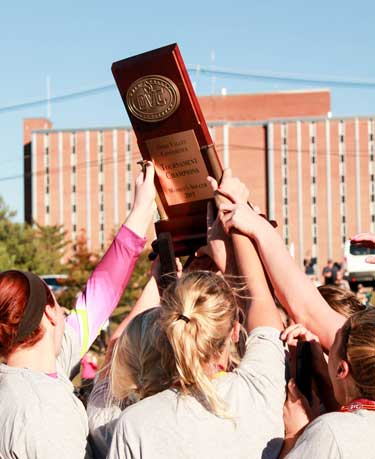 Jenny Rohl/The News The Racers celebrate their OVC Tournament win over Southeast Missouri State Nov 8.
