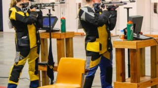 McKenna Dosier/The News Rifle team members prepare to take their shot in Pat Spurgin rifle range. The team was bumped to fourth in the nation.
