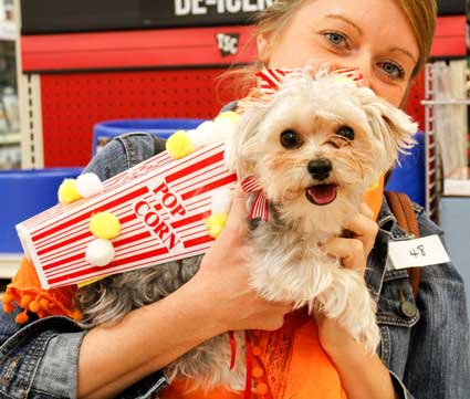 McKenna Dosier/The News Lea Ann Atherton and her puppy, Mille Julep, participating in this year's Barktoberfest.