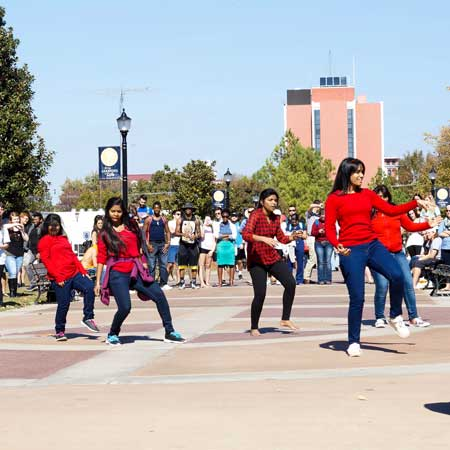 Zachary Maley/The News FLASH MOB: When dozens of students occupy one of the most popular walkways on campus in synchronized dance moves, it makes people pause, take many photos and enjoy the surprise show from the Indian Student Association.