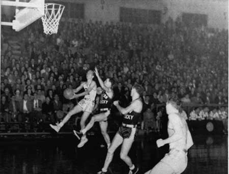 Photo courtesy of The Shield Bennie Purcell goes up for a layup in his junior season. He and his son, Mel, became professional athletes.