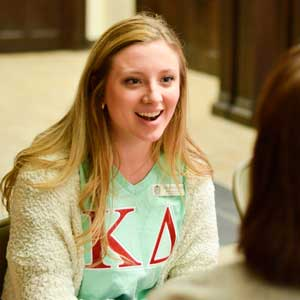 Emily Harris/The News Kappa Delta member Anne-Riley Meade speaks to a potential new member.