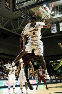 Kalli Bubb/The News Senior forward Jeffrey Moss comes down from a dunk during their game against the Saluki's.