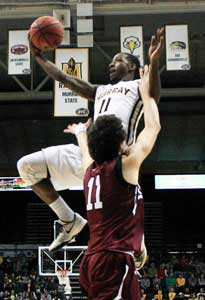 Kalli Bubb/The News SALUKI LOSS: Damarcus Croaker, junior guard, jumps for a layup during their Dec. 18, 2015 game against the Southern Illinois University Carbondale Saluki's.
