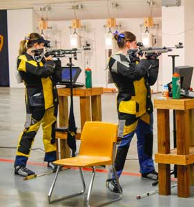 McKenna Dosier/The News Two members  of the shooting team at practice. The team returns to Murray for a tournament Jan. 23.