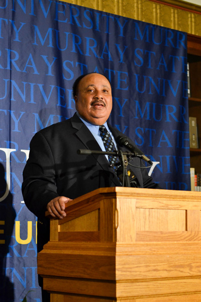 Above, Jenny Rohl/The News. Below, Chalice Keith/The News MARTIN LUTHER KING III: Above, this year's Presidential Lecture speaker, Martin King Luther III, speaks to a large crowd in Lovett Auditorium about the progress of civil rights since his father, Martin Luther King Jr. Below, King holds a press conference in Pogue Library.