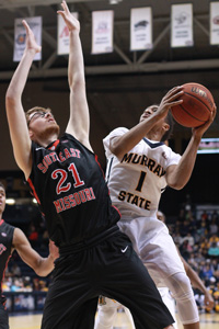 Jenny Rohl/The News Junior guard Bryce Jones goes up for a layup Saturday against the Redhawks.