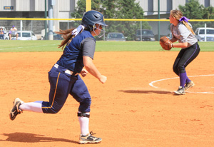 Kalli Bubb/The News A Murray State softball player runs to first base after hitting the ball in a game this fall.