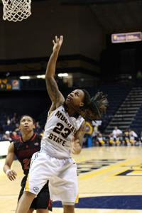 Nicole Ely/The News Junior guard LeAsia Wright rebounds the ball against in Southeast Missouri State Saturday.