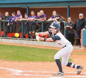 Jenny Rohl/The News Junior outfielder and utility player, Cayla Levins bunts the ball during the Racers' game against Evansville on March 17.
