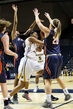 Nicole Ely/The News Senior forward Kyra Gulledge drives to the basket in Saturday's loss to UT Martin.