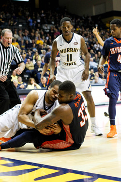 Nicole Ely/The News Senior forward Terron Gilmore steals the ball from UT Martin's senior forward Myles Taylor.