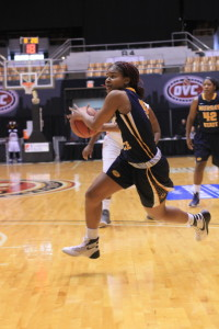 Jenny Rohl // The News Sophomore guard Jasmine Borders drives to the basket in Wednesday's game.