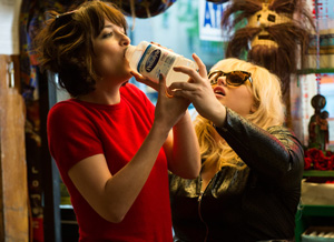 "Photo courtesy of www.warnerbros.co.uk Dakota Johnson (left) and Rebel Wilson (right) party as single women in the new comedy ""How to Be Single."""