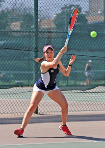 Photo courtesy of Dave Winder Senior from Mississauga, Ontario, Megan Blue hits the ball during the Racers' match Easter weekend.