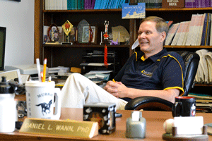 Chalice Keith/The News Daniel Wann, the recipient of this year's Distinguished Professor Award, sits in his office.