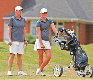 Photo Courtesy Dave Winder-Murray State Athletics Folke, the individual OVC Tournament champion, stands next to Head Coach Velvet Milkman as she strategizes her next shot on the second day.