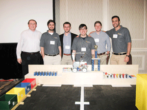 Photo courtesy of Alec Leedy  The award-winning team of Racers standing in front of their winning design after a second place victory last week at the SoutheastCon.