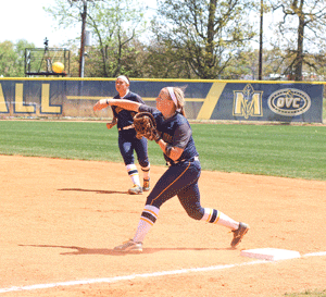 Nicole Ely/The News Junior infielder Jessica Twaddle throws the ball to third base in the team's Saturday loss.