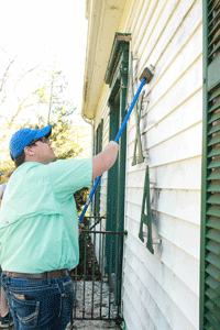 Kalli Bubb and Jenny Rohl/The News The Lambda Chi Alpha house was vandalized last Thursday, but other fraternities came together to repaint and fix the house.