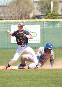 Jenny Rohl/The News Freshman infielder Jaron Robinson attempts to turn a double play during the Racers 9-3 loss on Sunday.
