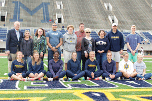 McKenna Dosier/The News Track and field seniors take the field to be honored alongside family, friends, professors and advisers during the Margaret Simmons Invitational on Saturday. The Racers graduate 12 women from the team.