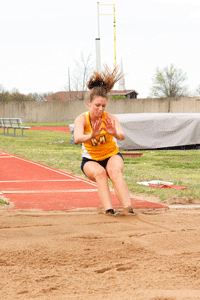 McKenna Dosier/The News HOME MEET: Senior jumper Jill Jachino competes in her final home meet at Saturday's Margaret Simmon Invitational.