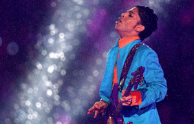 Photo courtesy of wgnradio.com  Prince performs during the halftime show at the 2007 Super Bowl in the pouring rain.