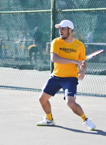 Chalice Keith/The News Marcel Ueltzhoeffer, sophomore from Oftersheim, Germany, finishes a forehand during the men's victory over Tennessee State.