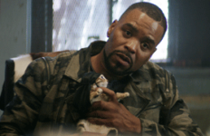 Photo courtesy of screenrant.com  Cheddar (Method Man) cuddles Keanu, the gangster cat, in a sit down with his original owners in newly released 'Keanu.'