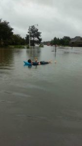 Photo courtesy of Kacie Fountain. Fountain's brother floats on a raft down their neighborhood street.