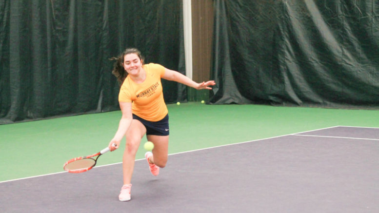 Amina Hadzic, sophomore from Esbjerg, Denmark stretches for a swing at Kenlake courts.