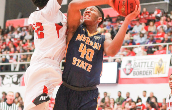 Freshman forward Jalen Dupree attacks the basket.