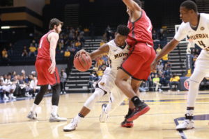 Senior guard Damarcus Croaker shoulders past SIUE defender.