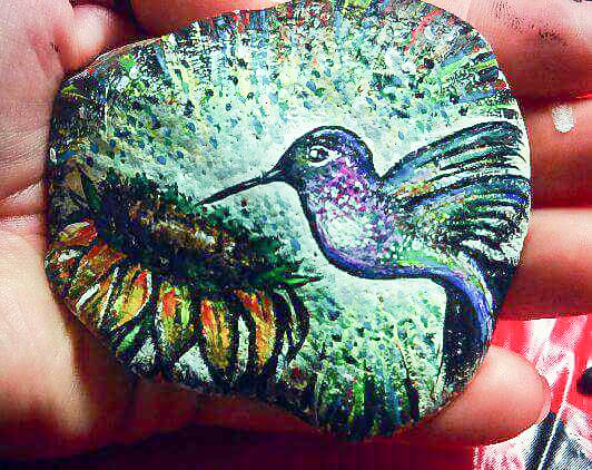 Painted Pebbles Spark Flame Of Unity